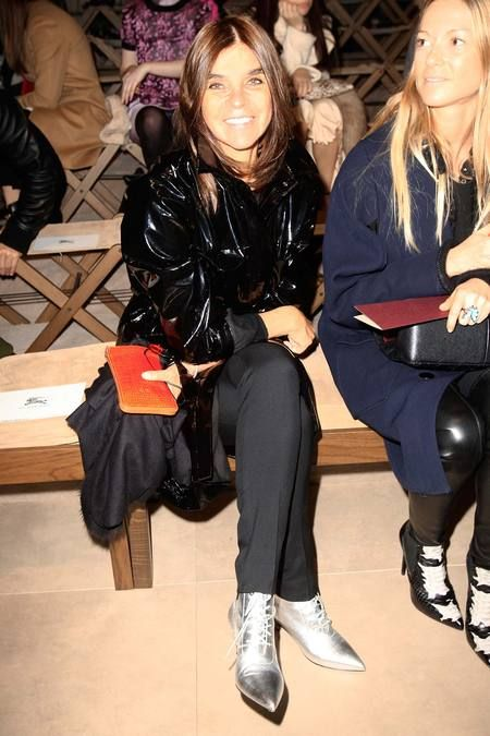 Carine Roitfeld wearing a silver cat boot front row at Burberry, photo@style.com